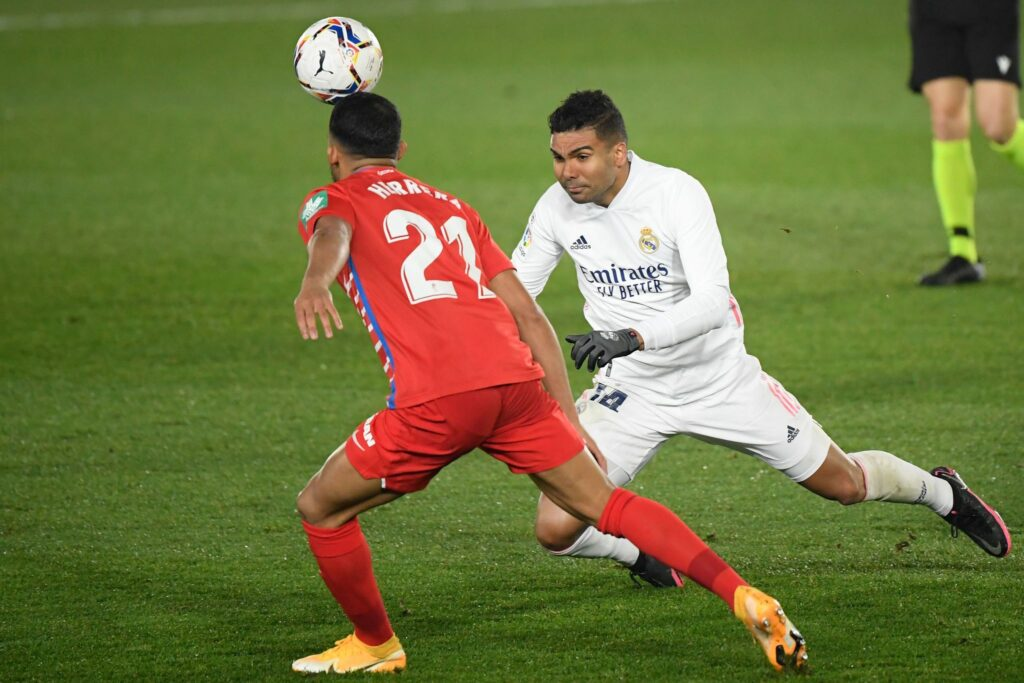 Real Madrid face Granada and must win to keep the pressure on league leaders Atletico Madrid.